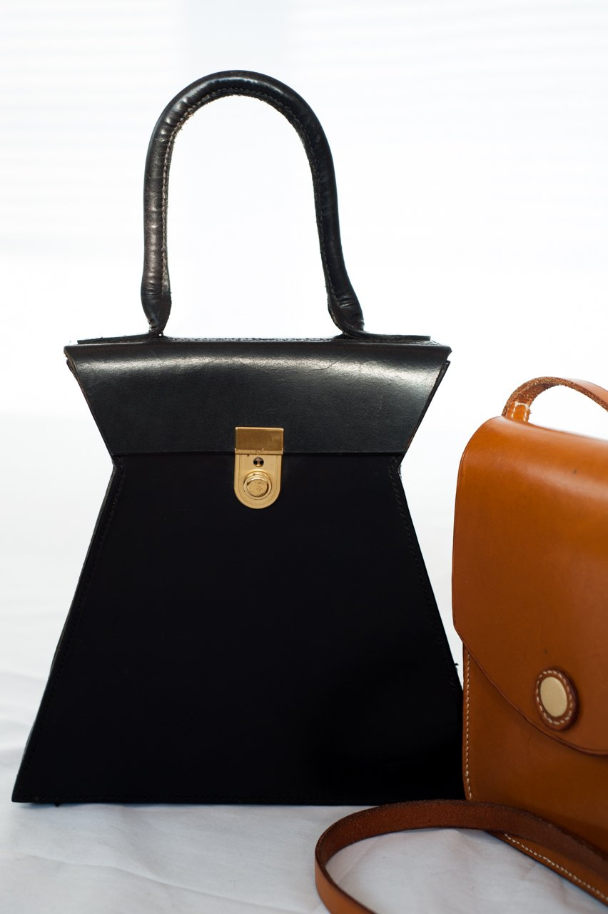 Driftwood Bag in black and The Salisbury Shoulder bag in tan